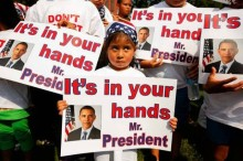 kids with president signs